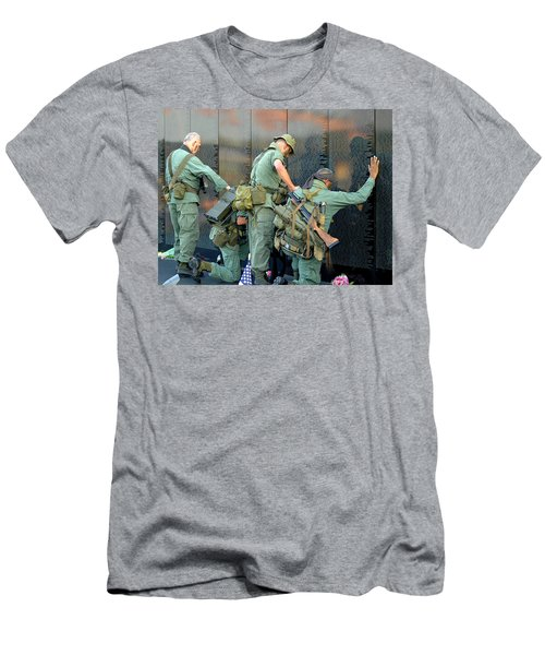 Men's T-Shirt (Slim Fit) featuring the photograph Veterans At Vietnam Wall by Carolyn Marshall