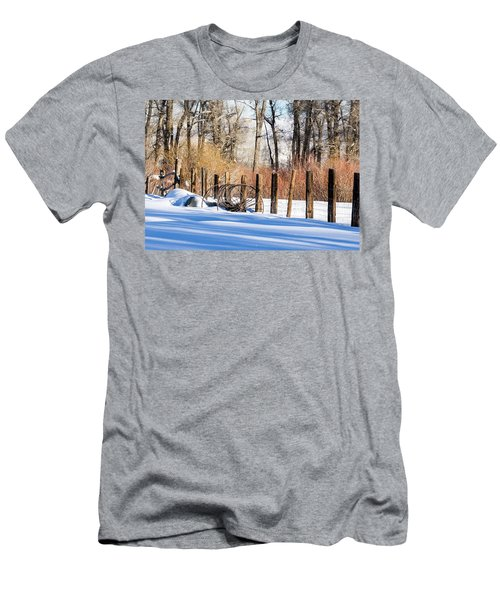 Men's T-Shirt (Athletic Fit) featuring the photograph Colorado Winter Snow Scene With Old Farming Rake And Rustic Fence by Nadja Rider