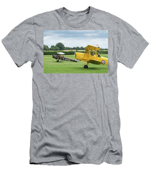 Men's T-Shirt (Athletic Fit) featuring the photograph De Havilland Tiger Moths Taxiing by Gary Eason