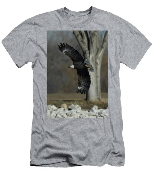 Men's T-Shirt (Slim Fit) featuring the photograph Eagle Soaring By Tree by Coby Cooper