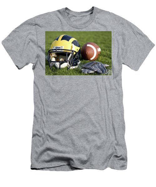 Helmet On The Field With Football And Gloves Men's T-Shirt (Athletic Fit)