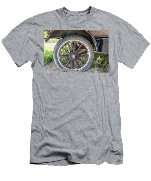 Men's T-Shirt (Slim Fit) featuring the photograph Old Truck Tire In Rural Rocky Mountain Town by Peter Ciro