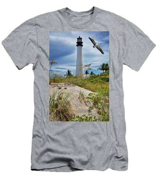 Pelican Flying Over Cape Florida Lighthouse Men's T-Shirt (Slim Fit) by Justin Kelefas
