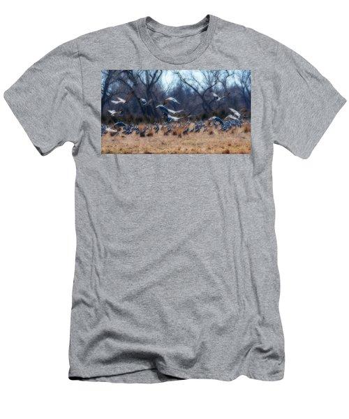Sandhill Crane Taking Flight Men's T-Shirt (Slim Fit) by Edward Peterson
