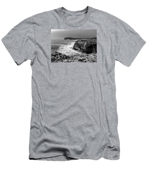 Men's T-Shirt (Slim Fit) featuring the photograph stormy sea - Slow waves in a rocky coast black and white photo by pedro cardona by Pedro Cardona