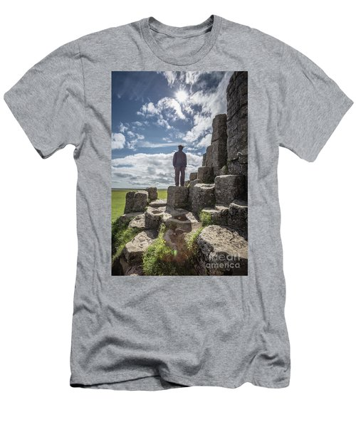 Men's T-Shirt (Athletic Fit) featuring the photograph Teen Boy Standing On Basalt Rocks by Edward Fielding