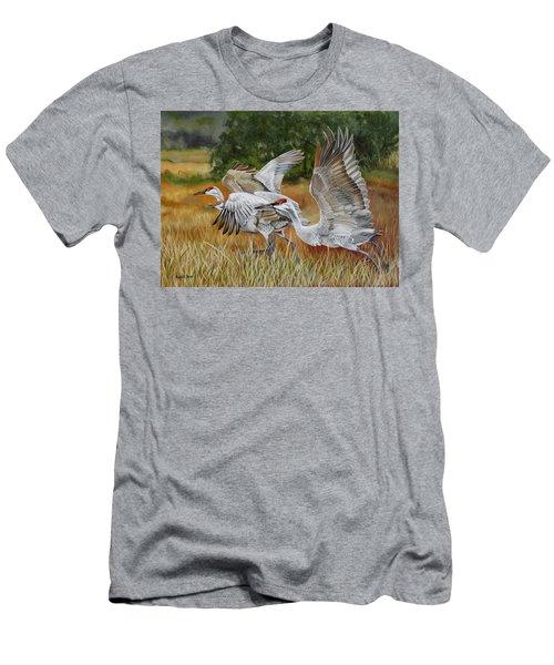 Sandhill Cranes In A Field Men's T-Shirt (Slim Fit) by Phyllis Beiser