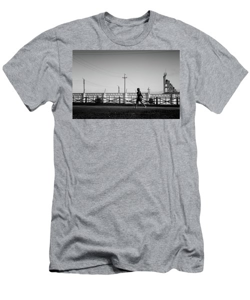 Men's T-Shirt (Athletic Fit) featuring the photograph Woman Walking In Industry by John Williams