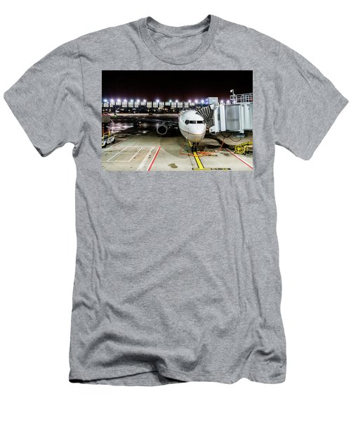 Men's T-Shirt (Athletic Fit) featuring the photograph Arrivals And Departure On Airplane At The Airport by Alex Grichenko