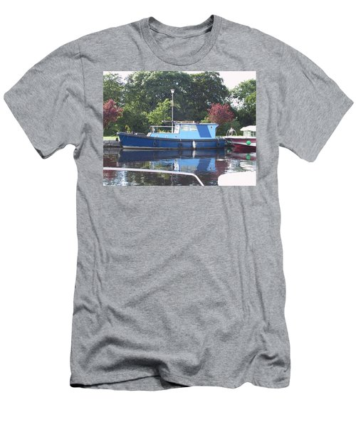 Men's T-Shirt (Athletic Fit) featuring the painting Blue Boat At Cloondara Harbour. by Val Byrne