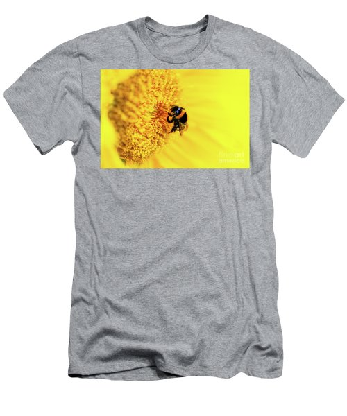 Macro Of A Honey Bee Crawling Over The Stamen Of A Bright Yellow Sunflower Blossom. Men's T-Shirt (Athletic Fit)