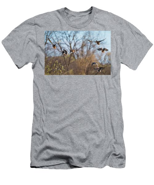 Men's T-Shirt (Athletic Fit) featuring the photograph Mallards Flying Away by Edward Peterson