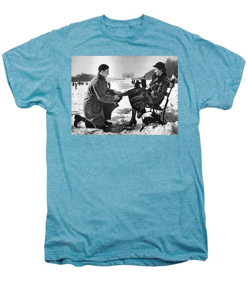 Man Lends A Helping Hand To Put On Skates Men's Premium T-Shirt by Underwood Archives
