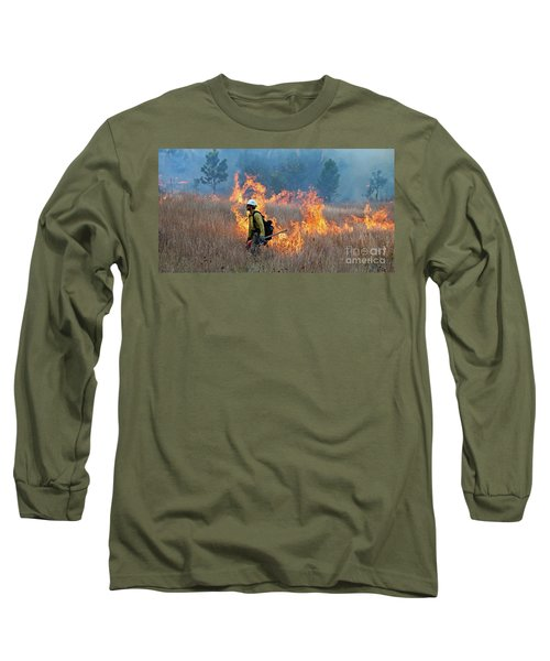 Long Sleeve T-Shirt featuring the photograph A Firefighter Ignites The Norbeck Prescribed Fire. by Bill Gabbert