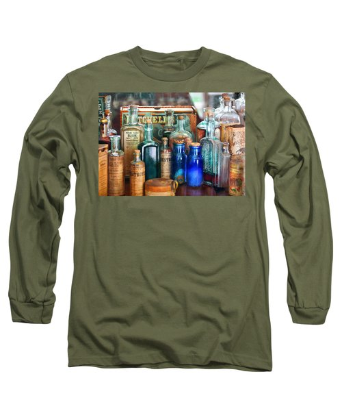 Apothecary - Remedies For The Fits Long Sleeve T-Shirt by Mike Savad