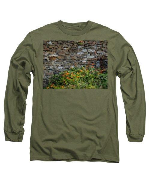 Orange Wildflowers Against Stone Wall Long Sleeve T-Shirt