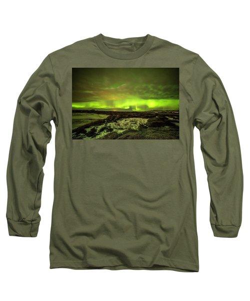 Aurora Borealis Over A Frozen Lake Long Sleeve T-Shirt by Joe Belanger