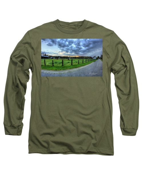 Storm Clouds Over Main Street Long Sleeve T-Shirt by John Loreaux