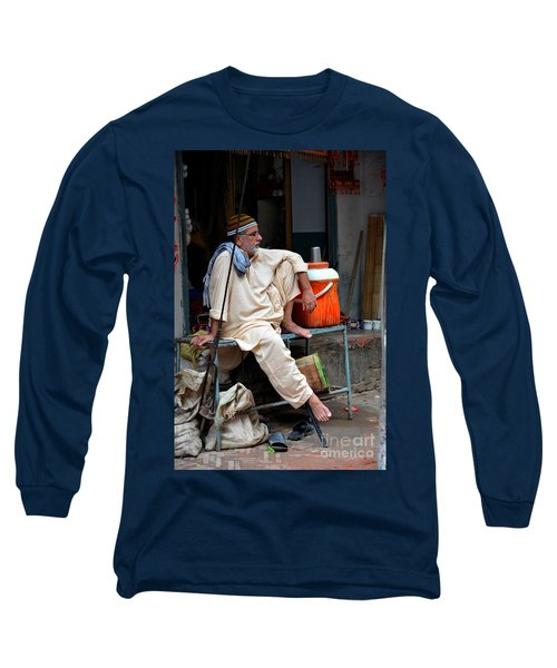 Man Sits And Relaxes In Lahore Walled City Pakistan Long Sleeve T-Shirt by Imran Ahmed