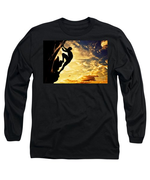 A Silhouette Of Man Free Climbing On Rock Mountain At Sunset Long Sleeve T-Shirt