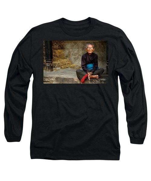 An Old Woman In Bhaktapur Long Sleeve T-Shirt by Valerie Rosen