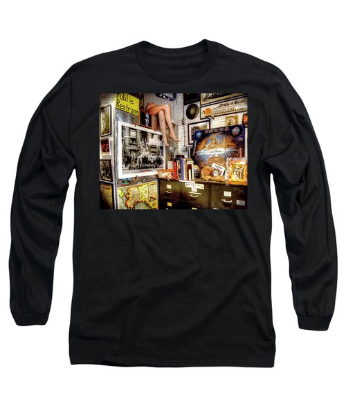 Legs In The Back Of The Shop Long Sleeve T-Shirt by Greg Sigrist