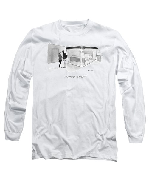 A Couple Looks At A Bed Encased In A Giant Long Sleeve T-Shirt