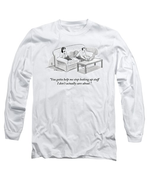 A Man And A Woman Sit On A Couch.  The Man Long Sleeve T-Shirt