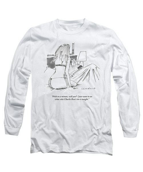 A Man In Bed With Remote Control  In Hand Ignores Long Sleeve T-Shirt