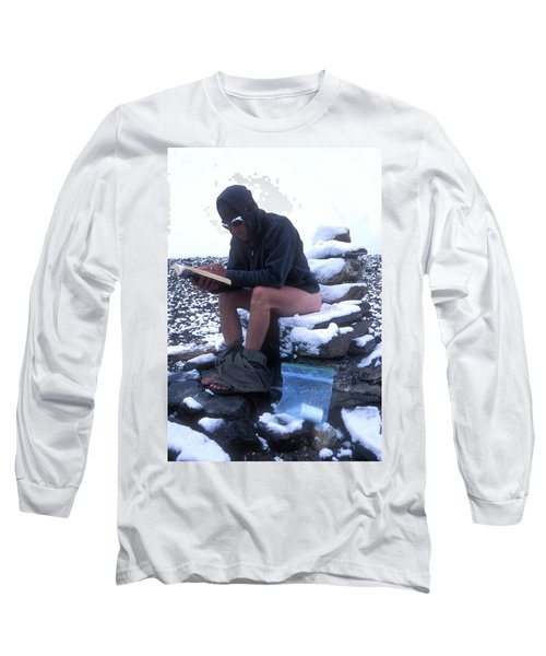 A Man Reads While Using A Snow-covered Long Sleeve T-Shirt