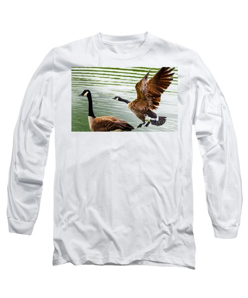 Long Sleeve T-Shirt featuring the photograph A Pair Of Canada Geese Landing On Rockland Lake by Jerry Cowart