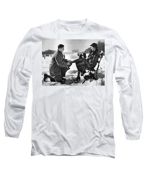 Man Lends A Helping Hand To Put On Skates Long Sleeve T-Shirt by Underwood Archives