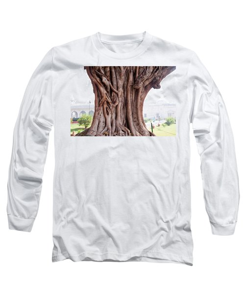 Long Sleeve T-Shirt featuring the photograph The Twisted And Gnarled Stump And Stem Of A Large Tree Inside The Qutub Minar Compound by Ashish Agarwal