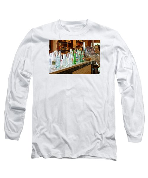 At The Store Long Sleeve T-Shirt by Steven Clipperton