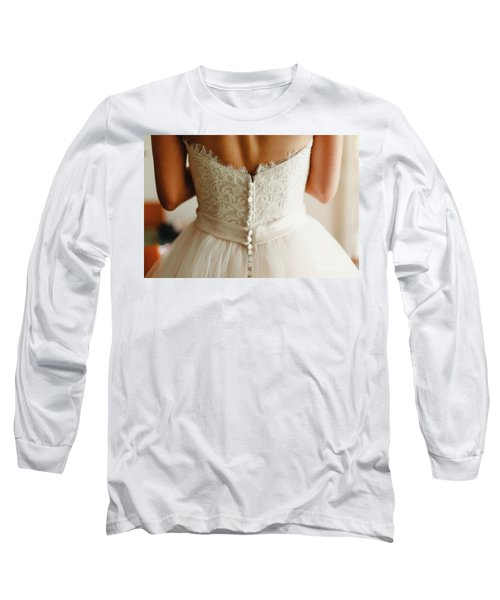 Bride Getting Ready, They Help Her By Buttoning The Buttons On The Back Of Her Dress. Long Sleeve T-Shirt