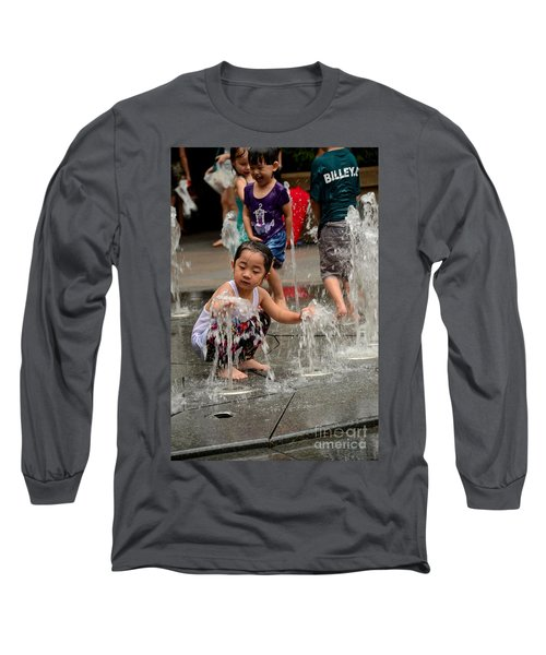 Clothed Children Play At Water Fountain Long Sleeve T-Shirt by Imran Ahmed