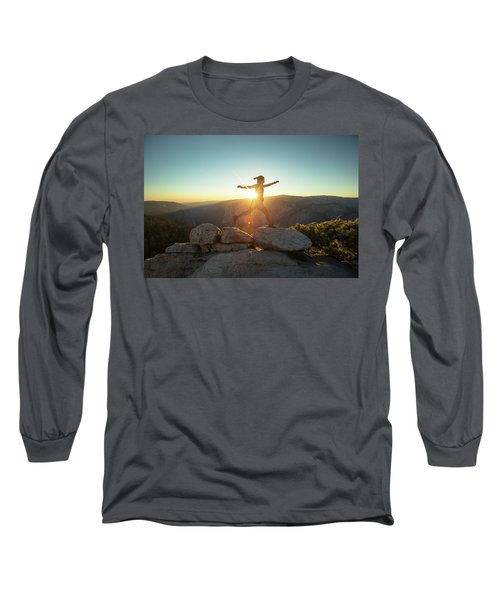Person Leaping Along Rocks At Sunset Long Sleeve T-Shirt