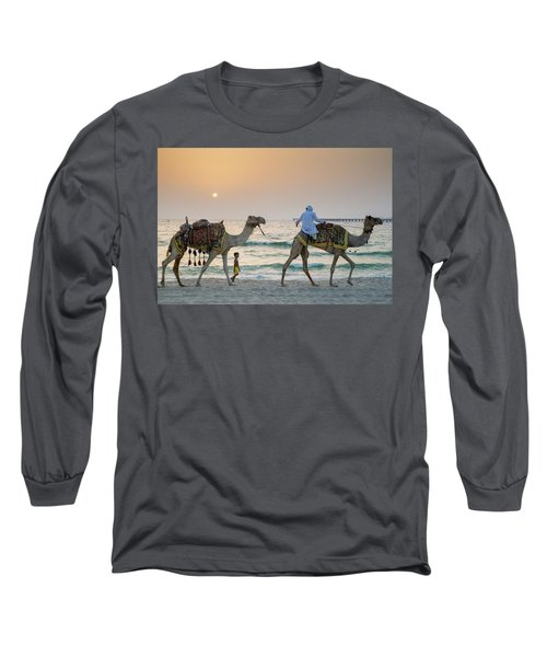 A Little Boy Stares In Amazement At A Camel Riding On Marina Beach In Dubai, United Arab Emirates Long Sleeve T-Shirt