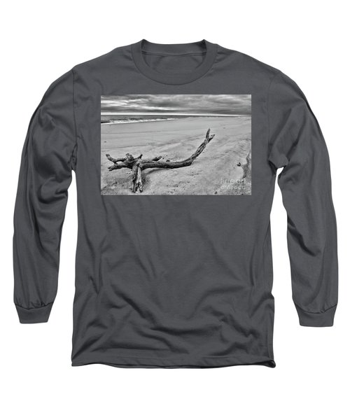 Driftwood On The Beach In Black And White Long Sleeve T-Shirt by Paul Ward
