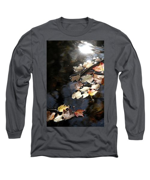 Long Sleeve T-Shirt featuring the photograph Dry Leaves Floating On The Surface Of A Stream by Emanuel Tanjala