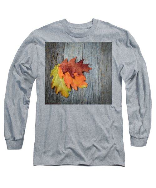 Autumn Leaves On Rustic Wooden Background Long Sleeve T-Shirt