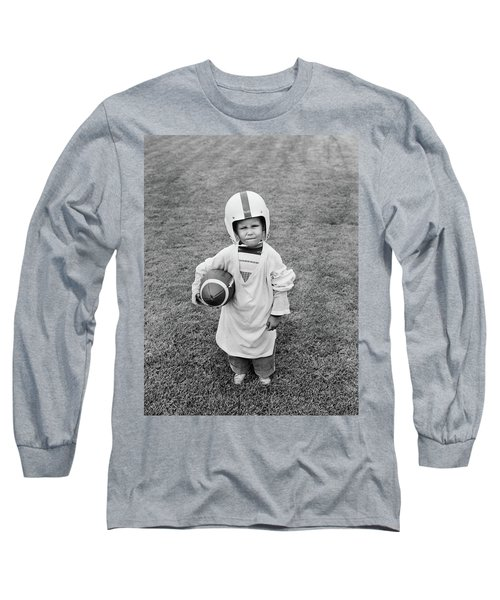 1950s Boy Standing In Grass Wearing Long Sleeve T-Shirt