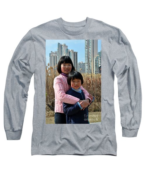 Two Chinese Teen Sisters Hug  And Embrace Shanghai China Long Sleeve T-Shirt by Imran Ahmed