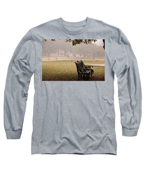 Long Sleeve T-Shirt featuring the photograph A Wrought Iron Black Metal Bench Under A Tree In The Qutub Minar Compound by Ashish Agarwal