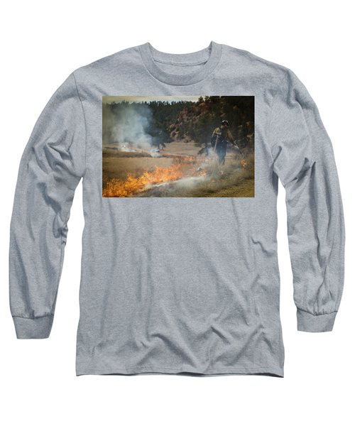 Long Sleeve T-Shirt featuring the photograph Firefighter Ignites The Pleasant Valley Prescribed Fire by Bill Gabbert