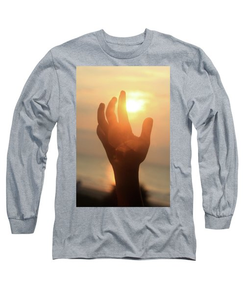 Hand Reaching Fore The Sun Long Sleeve T-Shirt by Emanuel Tanjala