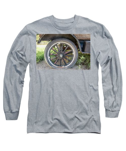 Old Truck Tire In Rural Rocky Mountain Town Long Sleeve T-Shirt by Peter Ciro