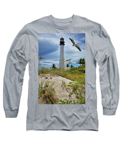 Long Sleeve T-Shirt featuring the photograph Pelican Flying Over Cape Florida Lighthouse by Justin Kelefas