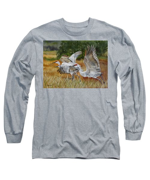Sandhill Cranes In A Field Long Sleeve T-Shirt by Phyllis Beiser
