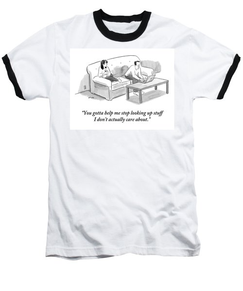 A Man And A Woman Sit On A Couch.  The Man Baseball T-Shirt